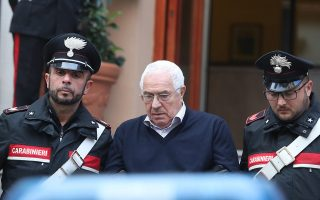 epa07207525 Settimino Mineo (C), 80 years old, considered as Sicilian Mafia's Toto Riina successor, is escorted by Italian Carabinieri officers after his arrest in Palermo, Sicily Island, southern Italy, 04 December 2018. After a massive operation, the alleged new head of 'Cosa Nostra' was arrested along with 45 others in the Sicilian capital, Palermo. Mineo reportedly took over as the head of Cosa Nostra following the death in 2017 of Mafia 'boss of bosses' Salvatore 'Toto' Riina.  EPA/IGOR PETYX