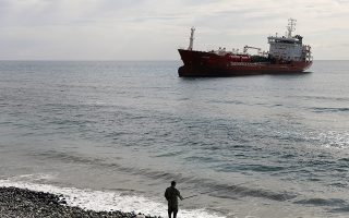 The M/V Athlos tanker is seen anchored following a fire that broke out on board injuring two members of the crew, according to local media, off the shores of Zygi, Cyprus December 29, 2018. REUTERS/Yiannis Kourtoglou