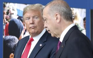 U.S. President Donald Trump, left, talks to Turkish President Recep Tayyip Erdogan as they tour the new NATO headquarters in Brussels, Belgium, Wednesday, July 11, 2018. NATO countries' heads of states and governments gather in Brussels for a two-day meeting. (Tatyana Zenkovich/pool photo via AP)