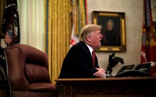 U.S. President Donald Trump holds a video call with U.S. military service members in the Oval Office on Christmas morning in Washington, U.S., December 25, 2018. REUTERS/James Lawler Duggan
