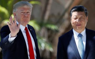 President Donald Trump and Chinese President Xi Jinping pause for photographs at Mar-a-Lago, Friday, April 7, 2017, in Palm Beach, Fla. Trump was meeting again with his Chinese counterpart Friday, with U.S. missile strikes on Syria adding weight to his threat to act unilaterally against the nuclear weapons program of China's ally, North Korea. (AP Photo/AlexBrandon)