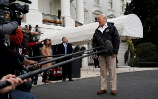U.S. President Donald Trump talks to the media on the South Lawn of the White House in Washington, U.S., before his departure to California, November 17, 2018. REUTERS/Yuri Gripas