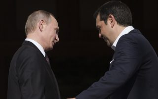 Greek Prime Minister, Alexis Tsipras, right, welcomes Russian President, Vladimir Putin before their meeting in Athens, Friday, May 27, 2016. Russia's president is travelling to financially struggling Greece for a visit that will include a trip to a secluded, male-only Christian Orthodox sanctuary in the country's north. (AP Photo/Petros Giannakouris)