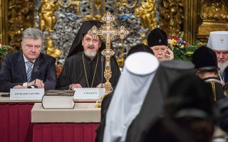 Ukraine's President Petro Poroshenko (L), a special envoy of Ecumenical Patriarch Metropolitan Emmanuel of France (C), and head of the Ukrainian Orthodox Church of the Kiev Patriarchate Patriarch Filaret attend a church council to convene to create an independent Ukrainian Orthodox church at the Saint Sophia's Cathedral in Kiev, Ukraine December 15, 2018. Mykhailo Markiv/Ukrainian Presidential Press Service/Handout via REUTERS ATTENTION EDITORS - THIS IMAGE WAS PROVIDED BY A THIRD PARTY.