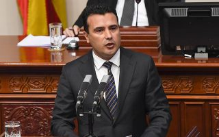 epa07094461 Macedonian Prime Minister Zoran Zaev  addresses members of the parliament at the beginning of the parliamentary session on changing the state's constitution in Skopje, The Former Yugoslav Republic of Macedonia (FYROM), 15 October 2018. After the referendum held on September 30, the FYROM government submits a proposal to the parliament for the change of the state's constitution, to change the country's name to 'Republic of Northern Macedonia' to endorse a name deal between FYR of Macedonia and Greece and to qualify for NATO membership. It is necessary to have two third majority, (80 members of the parliament) to change the constitution of the state.  EPA/GEORGI LICOVSKI