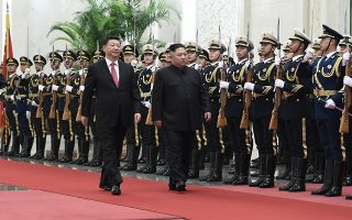 In this Tuesday, Jan. 8, 2019, photo released by China's Xinhua News Agency, Chinese President Xi Jinping, left, and North Korean leader Kim Jong Un review an honor guard during a welcome ceremony at the Great Hall of the People in Beijing. A special train believed to be carrying Kim Jong Un departed Beijing on Wednesday after a two-day visit by the North Korean leader to the Chinese capital. (Shen Hong/Xinhua via AP)