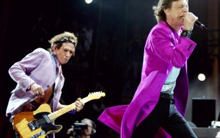 Rolling Stones lead singer Mick Jagger, right, and Keith Richards  perform at the Concert for SARS Relief at  Downsview Park in Toronto Wednesday July 30, 2003. The Rolling Stones along with more than 15 other acts and was expected to draw more than 450,000 people. (AP Photo/Kevin Frayer)