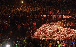 epa07290905 Gdansk residents gather with candles forming a huge heart in front of the Solidarnosc Square in Gdansk, Poland, 16 January 2019 where they paid homage to the deceased mayor of the city, Pawel Adamowicz. Mayor of Gdansk Pawel Adamowicz died in hospital on 14 January afternoon from wounds suffered in a Sunday evening knife attack during the 27th finale of the Great Orchestra of Christmas Charity in Gdansk.  EPA/Adam Warzawa POLAND OUT