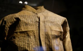 A jacket the Nazis had Jewish prisoners make out of Torah parchments is seen on display at