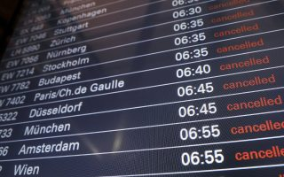 Cancelled flights are indicated on a display board at the airport in Hamburg, Germany, Tuesday, Jan. 15, 2019. Flights across Germany are facing disruption after security staff at eight airports went on strike over pay. (Christian Charisius/dpa via AP)