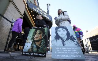 FILE- In this Jan. 25, 2019, file photo Brenda Jenkyns, left, and Catherine Van Tighem who drove from Calgary, Canada stand with signs outside of the premiere of the