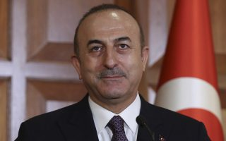 Turkey's Foreign Minister Mevlut Cavusoglu speaks to the media during a joint news conference with Macedonia's Foreign Minister Nikola Dimitrov in Ankara, Turkey, Thursday, Jan. 17, 2019. (Turkish Foreign Ministry via AP, Pool)