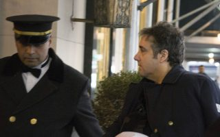 ADDS THAT COHEN'S LEFT ARM IS IN A SLING - Michael Cohen arrives at his home in New York with his left arm in a sling supported by a pillow Friday, Jan. 18, 2019. Democrats are vowing to investigate whether President Donald Trump directed Cohen, his personal attorney, to lie to Congress about a Moscow real estate project, calling that possibility a