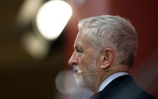 Britain's Labour Party leader Jeremy Corbyn delivers a speech at the Party of European Socialists congress in Lisbon, Portugal, Friday, Dec. 7, 2018. (AP Photo/Pedro Rocha)