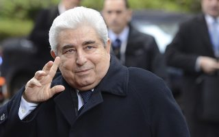 Cypriot President Demetris Christofias waves as he arrives for an EU summit in Brussels on Friday, Dec. 14, 2012. France and Germany have had more than their share of difference over the past few months, but this week at long last the two countries were able to find a compromise that allowed the European Union to realize a deal on a banking union. (AP Photo/Geert Vanden Wijngaert)