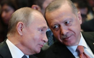 Russian President Vladimir Putin, left, listens to Turkey's President Recep Tayyip Erdogan through an interpreter, as they attend an event marking the completion of one of the phases of the Turkish Stream natural gas pipeline, in Istanbul, Monday, Nov. 19, 2018. (Mikhail Klimentyev, Sputnik, Kremlin Pool Photo via AP)