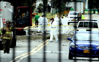 epaselect epa07294062 Members of the Colombian Technical Investigation Team (CTI) work at the place where a bomb car caused an explosion at the Escuela General Santander de la Policia (Santander General Police School) in Bogota, Colombia, 17 January 2019. At least eight people were killed by the detonation of a car bomb in a parking lot of the Santander General School, in the south of the Colombian capital.  EPA/MAURICIO DUENAS CASTANEDA