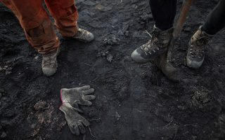 epa07328436 Detail of the boots and gloves of firefighters during the victim search after the breakage of a mineral residue dam of the Vale mining company, in Corrego do Feijao, Brazil, 28 January 2019. The chances of finding survivors after the mining tragedy that occurred on Friday in Brazil and that has already left 65 dead are 'very small', confirmed the firefighters on Monday. The death toll rose to 65 with the number of people missing, going down to 279 according  to the bulletin released Monday by the authorities of the state of Minas Gerais.  EPA/ANTONIO LACERDA