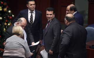 Macedonian Prime Minister Zoran Zaev, center, looks on following his speech on a session of the Macedonian Parliament in the capital Skopje, Wednesday, Jan. 9, 2019. Macedonian lawmakers were in the final stretch Wednesday of renaming their country North Macedonia as part of a deal with neighboring Greece in return for membership of NATO and potentially the European Union. (AP Photo/Boris Grdanoski)