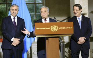 United Nations Secretary General Antonio Guterres addresses a news conference next to Cypriot President Nicos Anastasiades (R) and Turkish Cypriot leader Mustafa Akinci after the Conference on Cyprus at the European headquarters of the United Nations in Geneva, Switzerland, January 12, 2017. REUTERS/Pierre Albouy