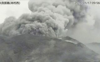 In this image from a surveillance camera released by Japan Meteorological Agency, a smoke column rises after an eruption of Shindake volcano in Kuchinoerabu island, southern Japan, Thursday, Jan. 17, 2019. Japan Meteorological Agency said Thursday's eruption of Shindake volcano caused volcanic rocks flying out of the crater and pyroclastic flows pouring down but have not reached as far as the residential area 2 kilometers (1.2 mile) away. (Japan Meteorological Agency via AP)