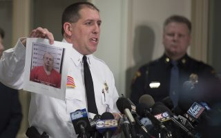 epa07275827 Baron County Sheriff Chris Fitzgerald holds up a photo of the suspect, Jake Thomas Patterson, as he announces that Jayme Closs was found alive, during a news conference in Baron, Wisconsin USA, 11 January 2018. Closs, the 13-year-old Wisconsin girl who went missing after parents were found shot to death has been missing for three months, was found in the town of Gordon, Wisconsin.  EPA/CRAIG LASSIG