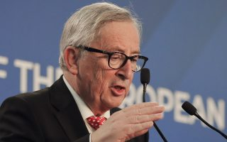 European Union's Commission President Jean-Claude Juncker gestures as he takes part in a joint press conference with Romanian Premier Viorica Dancila at the Victoria palace in Bucharest, Romania, Friday, Jan. 11, 2019 during a visit marking the official start of the Romanian Presidency of the Council of the European Union. (AP Photo/Vadim Ghirda)