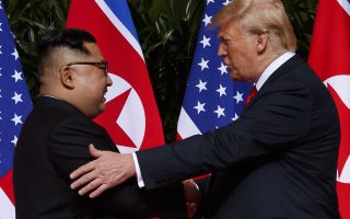 In this Tuesday, June 12, 2018, file photo, U.S. President Donald Trump meets with North Korean leader Kim Jong Un on Sentosa Island in Singapore.  A new poll from The Associated Press-NORC Center for Public Affairs Research released Thursday finds that 55 percent of Americans approve of Trump's diplomacy with North Korea, up from 42 percent in March and 34 percent last October. It's the highest rating for the Republican president on any individual issue on an AP-NORC poll since his inauguration.  (AP Photo/Evan Vucci, File)