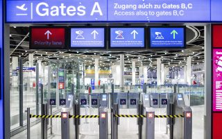 A security gate at the airport in Duesseldorf, western Germany, is closed Thursday morning, Jan. 10, 2019 when a strike of security staff at three airport caused severe disruption to flights. (Marcel Kusch/dpa via AP)