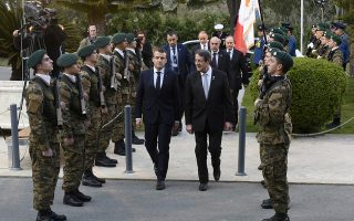 Cypriot President Nicos Anastasiades , right, and his French counterpart Emanuel Macron inspect the guard of honor before their meeting for the south EU summit in capital Nicosia, Cyprus, Tuesday, Jan. 29, 2019. Cyprus is hosting the leaders of France, Portugal, Malta, Greece, Spain and Italy for the fifth