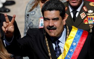 FILE PHOTO: Venezuela's President Nicolas Maduro gestures during the arrival for a special session of the National Constituent Assembly to present his annual state of the nation in Caracas, Venezuela January 14, 2019. REUTERS/Manaure Quintero/File Photo