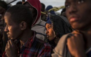 Migrants stay gather on the deck of the Spanish NGO Proactiva Open Arms rescue vessel after being rescued in the central Mediterranean sea on Dec. 21, 2018, before disembarking in the port of Crinavis in Algeciras, Spain, Friday, Dec. 28, 2018. Other European countries such as Italy, Malta or Greece closed their ports to the ship and only Spain admitted its entry. To reach Crinavis they have sailed for 6 days with more than 300 migrants on board. (AP Photo/Olmo Calvo)
