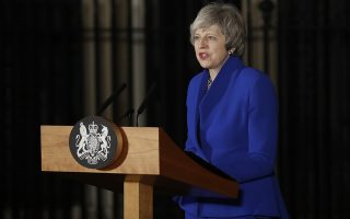 British Prime Minister Theresa May addresses the media in front of Downing street 10 in London, Wednesday, Jan. 16, 2019. British Prime Minister Theresa May's government has survived a no-confidence vote called after May's Brexit deal was overwhelmingly rejected by lawmakers. (AP Photo/Matt Dunham)