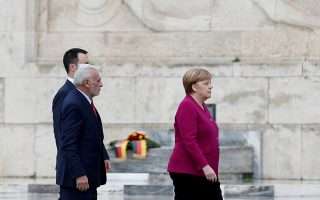 German Chancellor Angela Merkel attends a wreath-laying ceremony on the Tomb of the Unknown Soldier in Athens, Greece, January 11, 2019. REUTERS/Costas Baltas