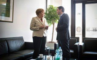 epa04717501 A handout picture made available by the German Federal government (Bundesregierung) on 23 April 2015 of German Chancellor Angela Merkel (L) and Greek Premier Minister ALexis Tsipras (R) talking to each other at the beginning of their meeting during the EU summit in Brussels, Belgium, 23 April 2015. The leaders of the European Union meet in Brussels to tackle an escalating migration crisis and the daily arrival of hundreds of would-be asylum seekers and migrants crossing the Mediterranean.  EPA/GUIDOBERGMANN/GERMANFEDERALGOVERNMENT/HANDOUT MANDATORY CREDIT HANDOUT EDITORIAL USE ONLY