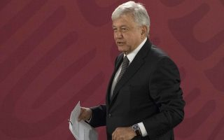 Mexico's President Andres Manuel Lopez Obrador arrives for his first news conference as president, which started at 7 a.m. local time in Mexico City, Monday, Dec. 3, 2018. Mexico's newly inaugurated president hit the ground running Monday with his pledge to govern as a common man and end decades of secrecy, heavy security and luxury enjoyed by past presidents. (AP Photo/Christian Palma)