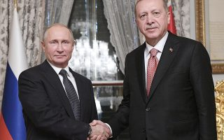 Russian President Vladimir Putin, left, and Turkey's President Recep Tayyip Erdogan shake hands prior to their talks in Istanbul, Monday, Nov. 19, 2018. (Ramil Sitdikov, Sputnik, Kremlin Pool Photo via AP)