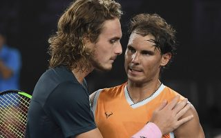 Spain's Rafael Nadal, right, is congratulated by Greece's Stefanos Tsitsipas after winning their semifinal at the Australian Open tennis championships in Melbourne, Australia, Thursday, Jan. 24, 2019.(AP Photo/Andy Brownbill)
