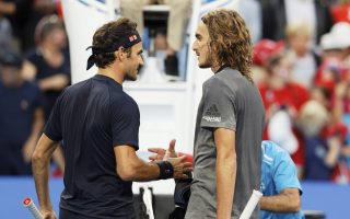 Switzerland's Roger Federer, left, shakes hands with Stefanos Tsitsipas of Greece at the net after winning their match at the Hopman Cup in Perth, Australia, Thursday Jan. 3, 2019. (AP Photo/Trevor Collens)