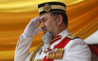 epa07264717 (FILE) - Malaysia's King Sultan Muhammad V salutes during the Trooping of Colours ceremony, in conjunction with his official birthday, in Putrajaya, Malaysia, 12 September 2018 (reissued 06 January 2019). According to Malaysia's National Palace (Istana Negara), Sultan Muhammad V of Kelantan has abdicated on 06 January 2019 as the country's 15th Agong, or Supreme Ruler, after just two years on the throne. The appointment of the king is rotated among nine of Malaysia's 13 states that have hereditary royal rulers.  EPA/AHMAD YUSNI *** Local Caption *** 54619320