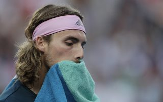 epa07314578 Stefanos Tsitsipas of Greece dries his face with a towel during his men's singles semifinal match against Rafael Nadal of Spain at the Australian Open Grand Slam tennis tournament in Melbourne, Australia, 24 January 2019.  EPA/LYNN BO BO