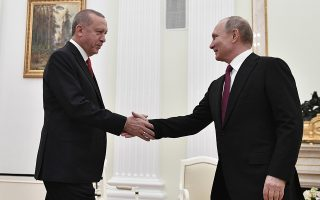 epa07312369 Russian President Vladimir Putin (R) shakes hands with Turkish President Recep Tayyip Erdogan (L) during their meeting at the Kremlin in Moscow, Russia, 23 January 2019. Turkish President is on a working visit to Moscow to discuss with his Russian counterpart the settlement process in Syria as well as various issues of bilateral cooperation.  EPA/ALEXANDER NEMENOV / POOL
