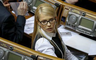 Ukrainian former Prime Minister and leader of Batkivshchyna (Fatherland) party Yulia Tymoshenko attends a parliament session in Kiev, Ukraine, February 16, 2016. A junior ally in Ukraine's ruling coalition quit on Wednesday, calling the alliance a