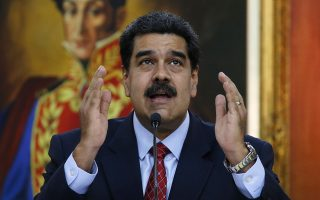 Venezuelan President Nicolas Maduro gives a press conference at Miraflores presidential palace in Caracas, Venezuela, Friday, Jan. 25, 2019, amid a political power struggle between him and an opposition leader who has declared himself interim president. (AP Photo/Ariana Cubillos)