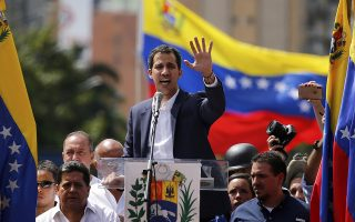 Juan Guaido, head of Venezuela's opposition-run congress, speaks to supporters at a rally where he declared himself interim president until new elections can be called in Caracas, Venezuela, Wednesday, Jan. 23, 2019. The opposition rally was called to demand President Nicolas Maduro's resignation. (AP Photo/Fernando Llano)