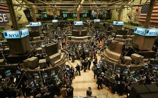 Activity is seen on the floor of the New York Stock Exchange Friday, Dec. 3, 2004, in New York.  Wall Street'sgyrations in 2004 had many investors scratching their heads. (AP Photo/stf/Richard Drew)