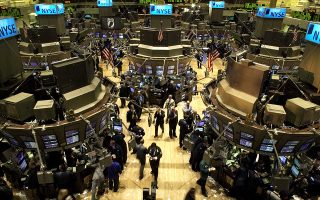 Traders work on the floor of the New York Stock Exchange Friday, March 4, 2005. The market closed with the Dow up 107.52, to 10,940.55, its best showing since closing at 10,948.38 on June 12, 2001.  (AP Photo/Adam Rountree)