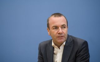 Manfred Weber, top candidate of the European People's Party group (EPP Group), for next year's European elections, attends a news conference in Berlin, Germany, Monday, Nov. 19, 2018. (AP Photo/Markus Schreiber)