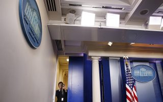 White House deputy press secretary Hogan Gidley takes a cell phone photograph of the press in the briefing room of the White House just before a surprise visit by President Donald Trump to speak to reporters about border security, Thursday, Jan. 3, 2019, in Washington. (AP Photo/Jacquelyn Martin)