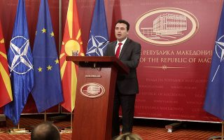 Macedonian Prime Minister Zoran Zaev addresses the media during a news conference at a government building in Skopje, Macedonia, Saturday, Jan. 12, 2019. Macedonia late Friday fulfilled its part of a historic deal that will pave its way to NATO membership and normalize relations with neighboring Greece, after lawmakers approved constitutional changes to rename the country North Macedonia. (AP Photo/Boris Grdanoski)